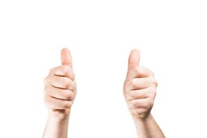 Hand showing thumbs up. All on white background.