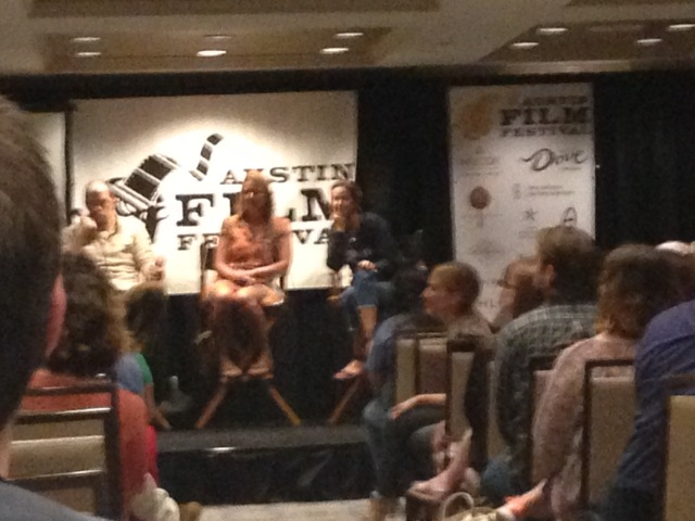 Blurry photo of the social media panel.